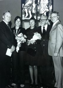 Millard Sheets, Sue Hertel, Helen and John Wallis and (bank official?) at a Home Savings opening