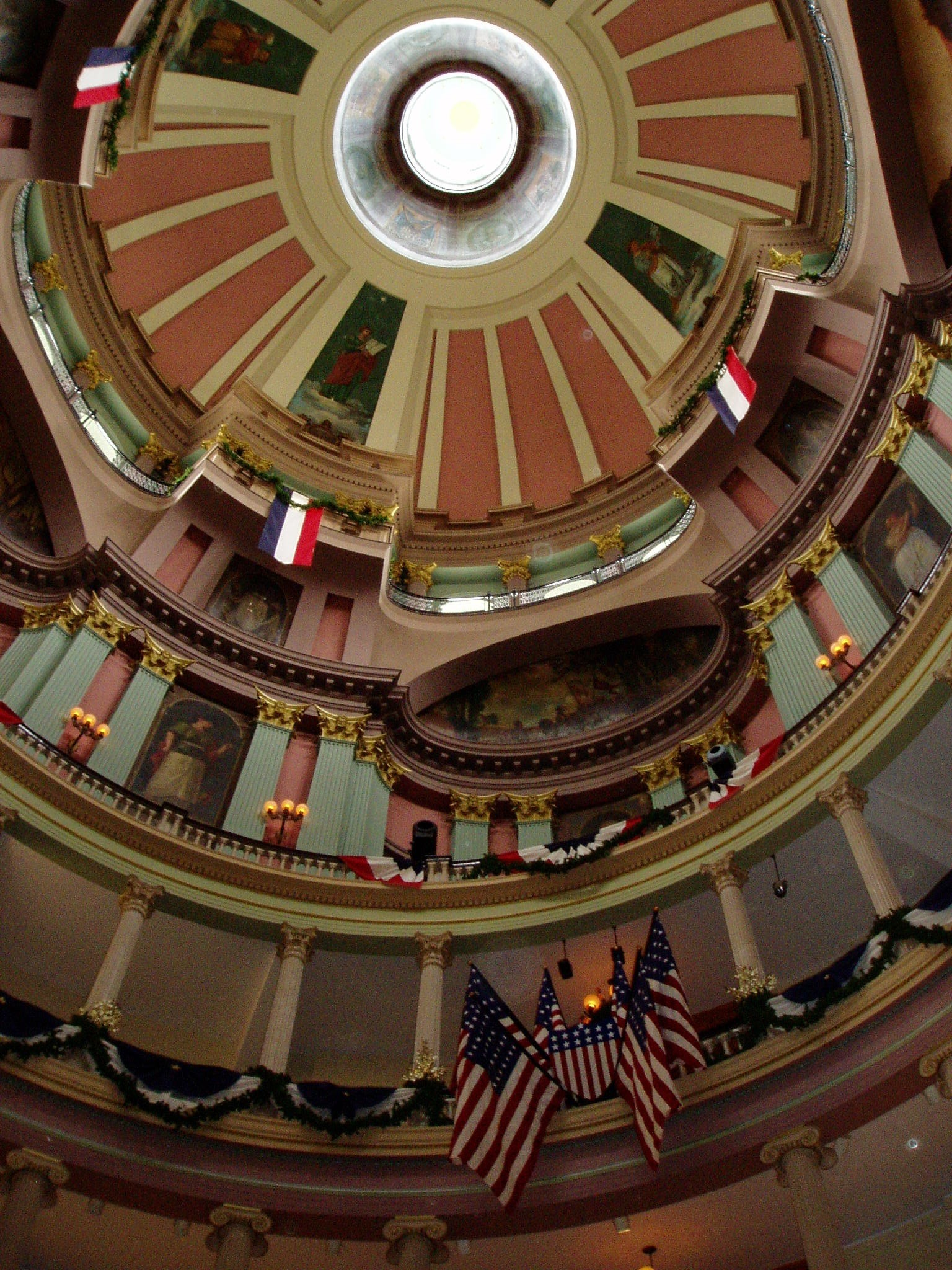 Old Courthouse Rotunda, St. Louis, site of Dred and Harriet Scott's petitions and Virginia Minor's efforts to vote; display of American flags and Carl Wimar's murals