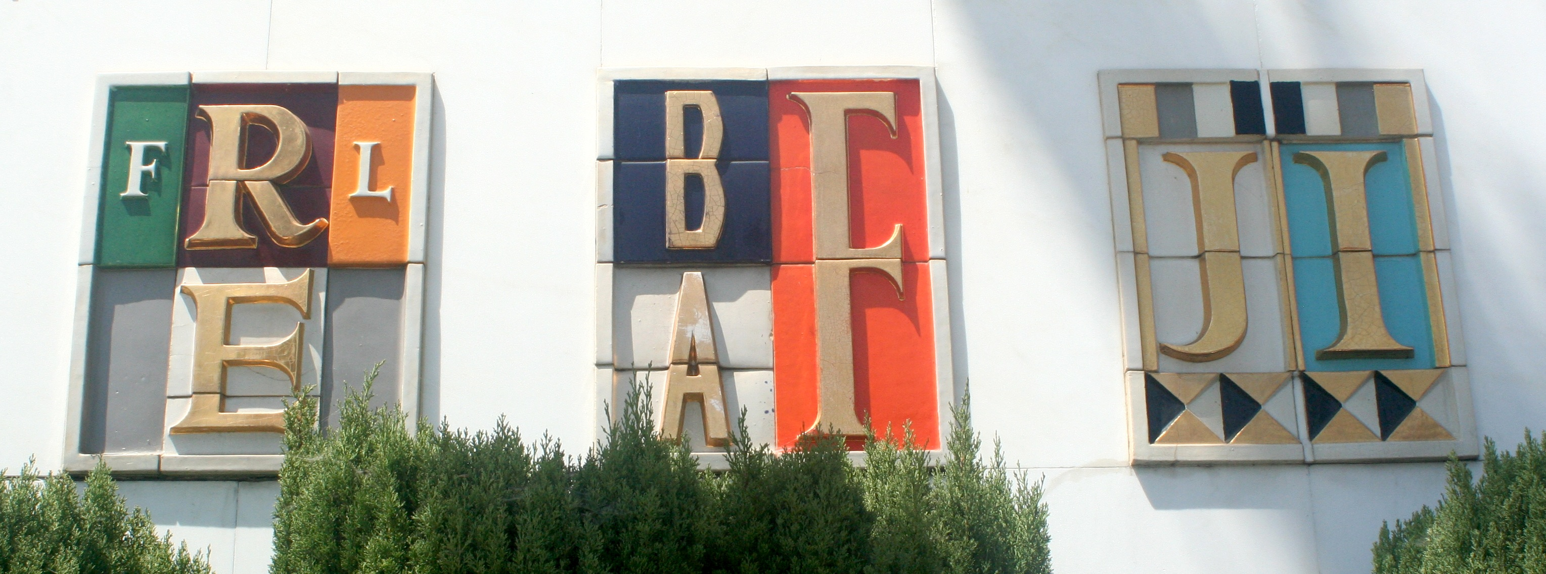 "Sheets Studio, logos for Fred L. Roberts Enterprises and Bay Area Finance and ""JI,"" Santa Monica, built 1957, photo 2012."